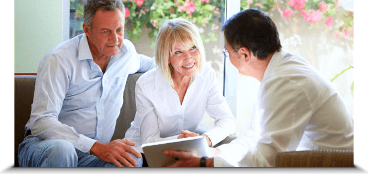 Stock Image of Old Couples Discussion with Doctor