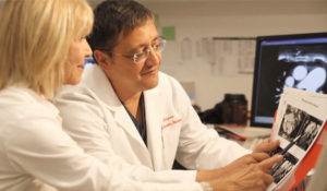 Dr. Madyoon Examines X-Ray with Co-Doctor
