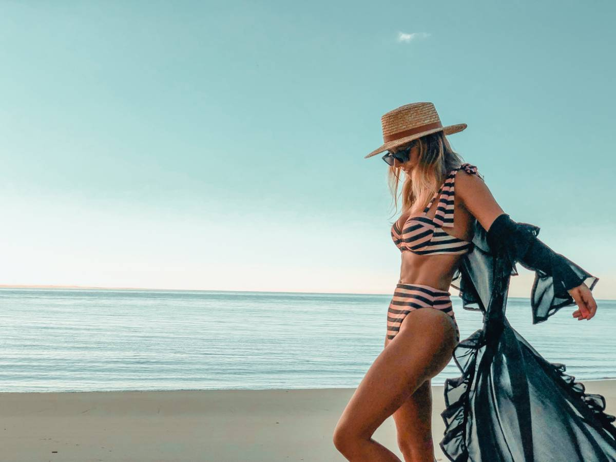 Woman under the sun which can cause spider veins.